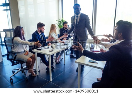 business mixed people multi international colleagues teamwork high five in a modern office with a panorama window #1499508011