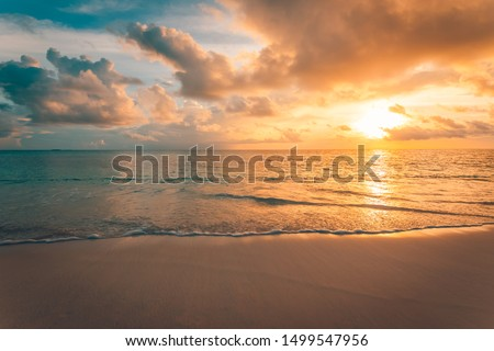 Closeup of sea beach and colorful sunset sky. Panoramic beach landscape. Empty tropical beach and seascape. Orange and golden sunset sky, soft sand, calmness, tranquil relaxing sunlight, summer mood #1499547956