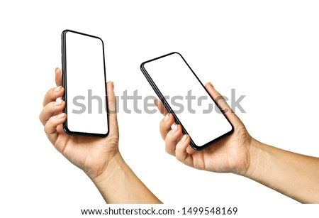 Woman hand holding the black smartphone with blank screen and modern frameless design in two rotated perspective positions  - isolated on white background Royalty-Free Stock Photo #1499548169