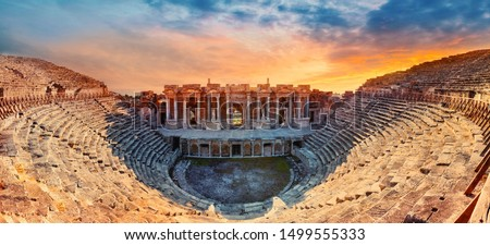 Amphitheater in ancient city of Hierapolis. Dramatic sunset sky. Unesco Cultural Heritage Monument. Pamukkale, Turkey #1499555333