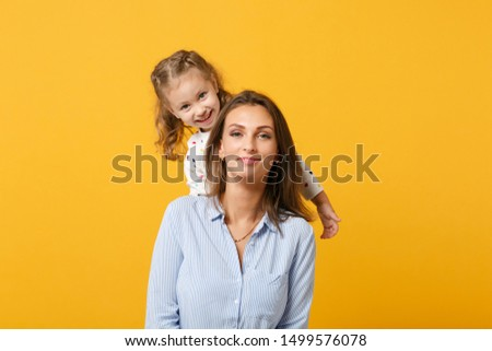 Woman in light clothes have fun with cute child baby girl 4-5 years old. Mommy little kid daughter isolated on yellow background studio portrait. Mother's Day love family parenthood childhood concept #1499576078