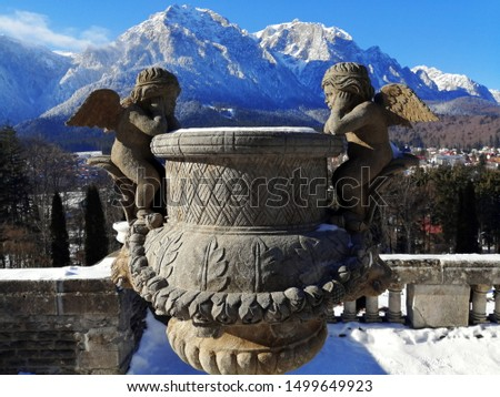 Stone Angels Looking At Eachother On The Romanian Bucegi Mountaing Snowy Backdrop #1499649923