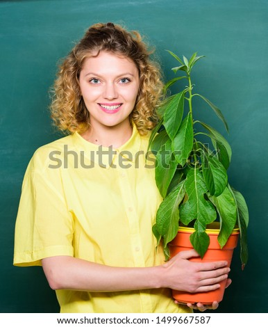 Botany education. Greenery benefits. Botany and nerd concept. Take good care plants. Botany and biology lesson. Botanical expert. Woman school teacher chalkboard background carry plant in pot. #1499667587