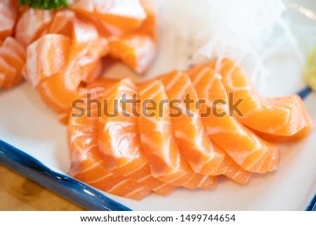 Salmon Sashimi with salmon belly, Japanese food restaurant.Fresh salmon fillet on white dish to make salmon slices. #1499744654