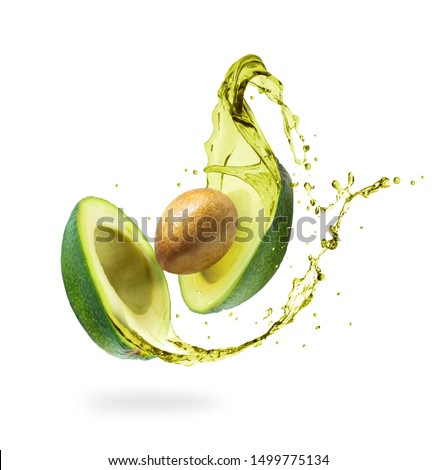 Sliced avocado with splashes isolated on white background #1499775134