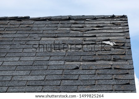 Roof shingles need to be replace Royalty-Free Stock Photo #1499825264