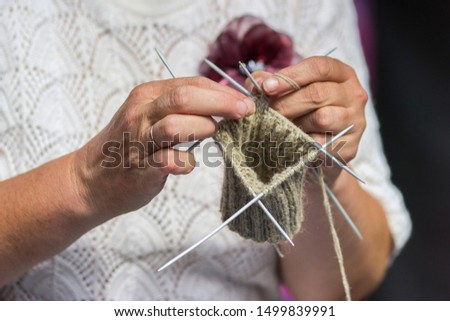 Knitting on knitting. Hands close-up knitting on knitting needles #1499839991