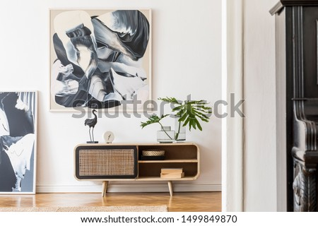 Modern design home interior of living room with wooden commode, black piano, tropical leafs, sculpture and elegant accessories. Stylish home decor. Mock up abstract paintings on the wall. Template. #1499849870