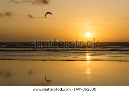 Sunset kite surfer at Westward Ho! Royalty-Free Stock Photo #1499862830