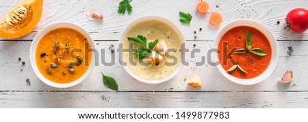 Soup Assortment. Set of various seasonal vegetable soups and organic ingredients, banner, copy space. Homemade colorful vegan vegetarian soups. #1499877983