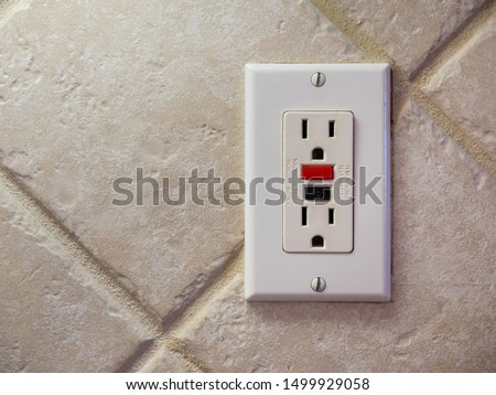 Ground fault interrupter electricity receptacle and wall plate. Residential electric socket plug with GFI reset button. #1499929058