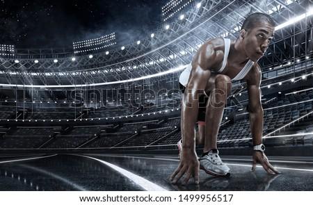 Sport. Sprinter leaving starting blocks on the running track.  #1499956517