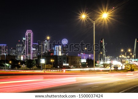 The view of Dallas Texas streets at night. From the outskirts of the city scape to the inner club scene of Deep Ellum, it is truly a lively scene. #1500037424