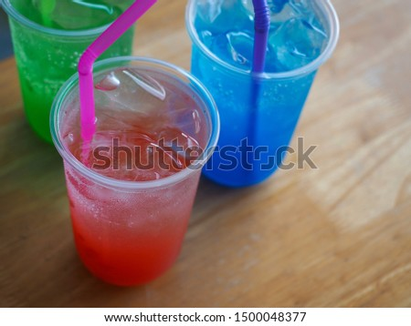 Red Soda and Blue Soda and Green Soda Resting on a wooden table Ready to be served for refreshment #1500048377