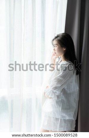 Women standing near window in the morning /thinking concept/ morning activities #1500089528
