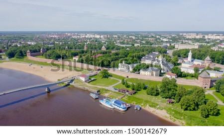 Veliky Novgorod, Russia. Novgorod Kremlin (Detinets), Volkhov River. Flight over the city, From Drone   #1500142679
