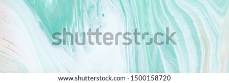 photography of abstract marbleized effect background. turquoise, gold, blue and white creative colors. Beautiful paint. banner Royalty-Free Stock Photo #1500158720