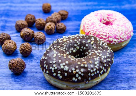 Round cookies with chocolate icing sprinkled with white crumbs. Food and drinks. #1500201695