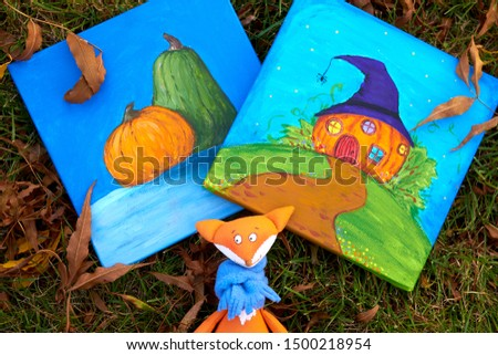 Two paintings (picture) with pumpkins (Jack-o'-lantern), fox and Happy Halloween theme on green grass with autumn leaves
