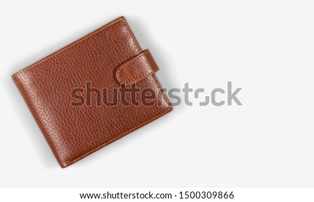 Top view of New black genuine leather wallet with banknotes and credit card inside isolated on white background. Royalty-Free Stock Photo #1500309866