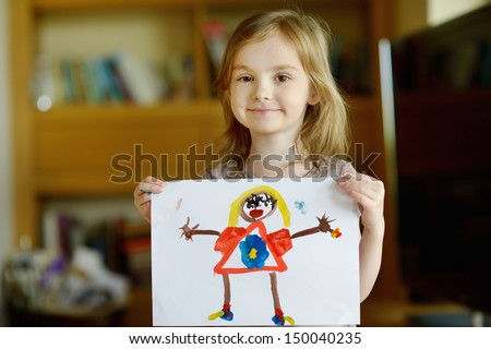 Little presch?oler girl displaying her picture proudly