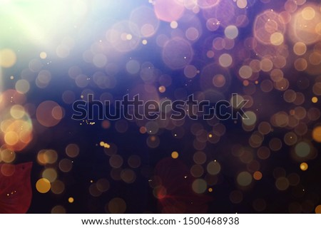 Abstract Golden glare on abstract bokeh background #1500468938