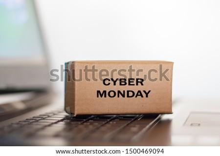 Carton box on computer. Cyber Monday shopping concept #1500469094