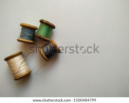 wooden spools on white background #1500484799