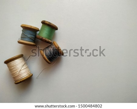 wooden spools on white background #1500484802