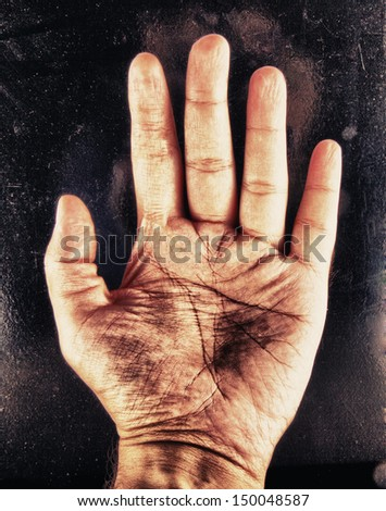 Close up of male hand over black background #150048587