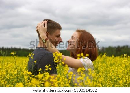 Beautiful couple in a yellow rapeseed field #1500514382