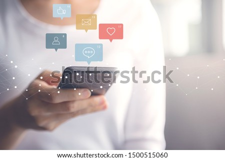 Woman hands using mobile smartphone with icon social media social network and marketing. #1500515060