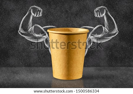 Power coffee. Cup of coffee on the background of depicted muscles on chalkboard. Strong power, muscle arms. Power concept.  #1500586334
