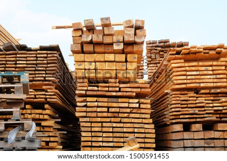 Wooden planks for construction are sold in the market. Stack of new wooden planks. Close up. #1500591455