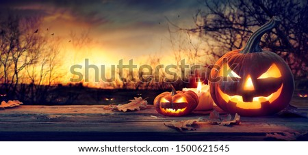 Jack O' Lanterns In Spooky Forest With Ghost Lights - Halloween Background  #1500621545