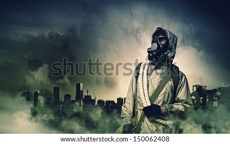 Man in gas mask against disaster background. Pollution concept #150062408