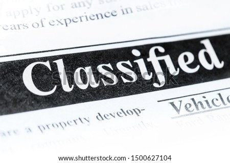 Classifieds ad section in newspaper #1500627104