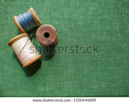 wooden spools on green background #1500646889