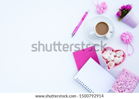 Flat lay girly, pale pink items for planning, notepads, pens, office work or working at home on her laptop, on the pale white background, with place for labels. Concept Desk. #1500792914