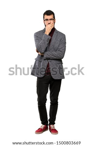 Handsome man with glasses covering mouth with hands over isolated white background Royalty-Free Stock Photo #1500803669