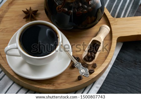 Pour over coffee brewing method. Making pour over coffee with hot water being poured from a kettle. , jam in a jar, coffee grains on a , pour over brewing pour over coffee on a dark background         #1500807743