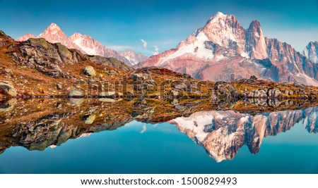 Calm autumn view of Cheserys lake with Mount Blanc on background, Chamonix location. Fantastic evening scene of Vallon de Berard Nature Preserve, Alps, France, Europe. #1500829493