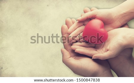 adult and child hands holiding red heart, heart health and donation concept #1500847838