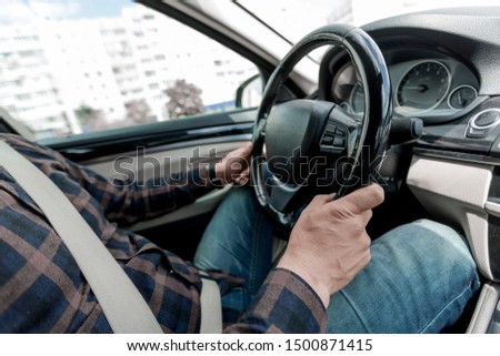 close up. a man sitting behind the wheel of a car. #1500871415