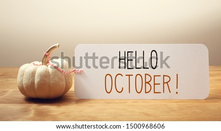 Hello October message with a white small pumpkin #1500968606