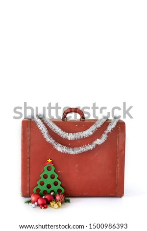 Vintage suitcase with Christmas decorations on white background. Christmas holiday concept #1500986393