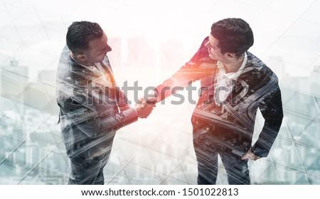 Agreement of Partnership Concept - Double exposure image of businessmen handshake. Corporate teamwork, trust partner and work agreement. #1501022813