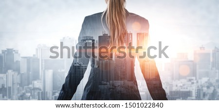 Double Exposure Image of Business Person on modern city background. Future business and communication technology concept. Surreal futuristic cityscape and abstract multiple exposure graphic interface. #1501022840