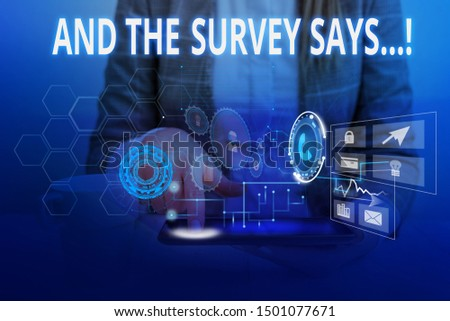 Word writing text And The Survey Says. Business concept for written spoken results of short quiz or exam on internet Woman wear formal work suit presenting presentation using smart device. #1501077671