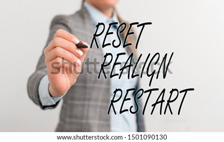 Conceptual hand writing showing Reset Realign Restart. Business photo text Life audit will help you put things in perspectives Business woman pointing in empty space with pen. #1501090130